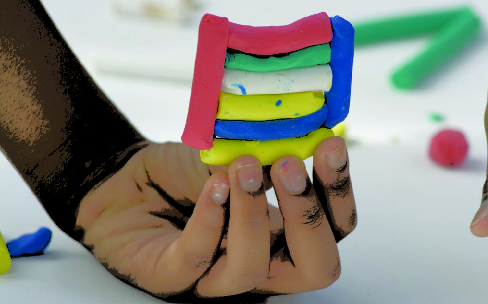 kid holding clay molding
