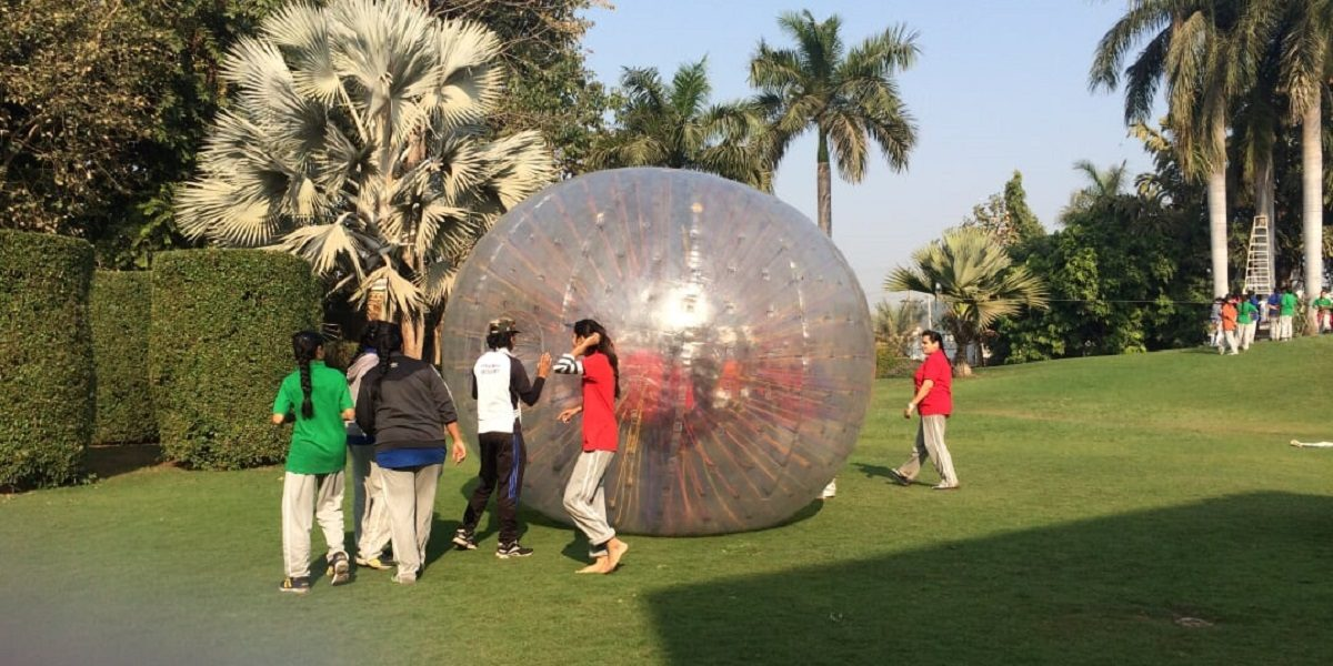 Zorbing ball rolling on grass