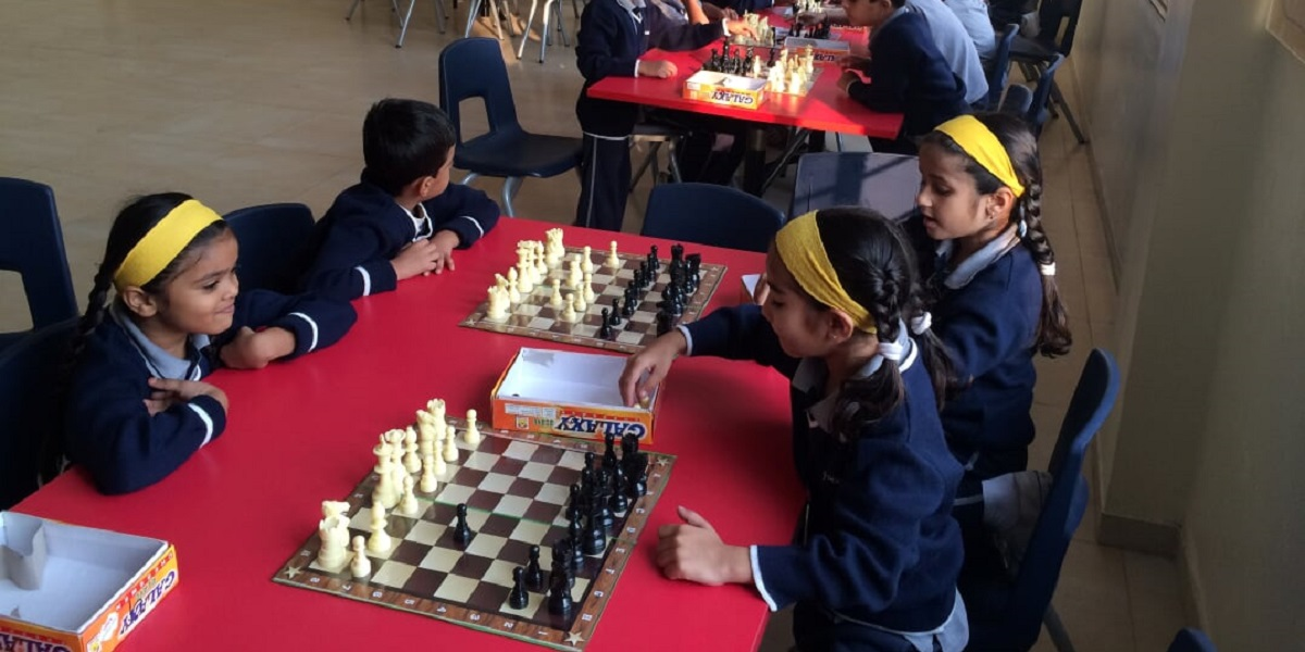 kids practicing chess